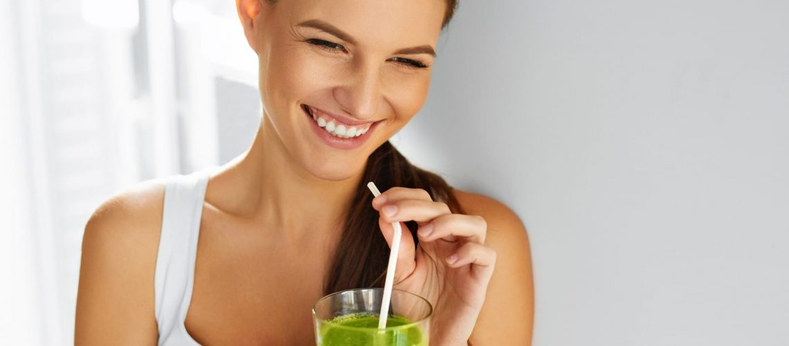Young smiling woman drinking Gut Repair for leaky gut